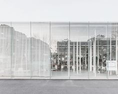 Reflecting the surrounding cherry blossom trees onto its transparent façade, the 'KAIT' studio/workplace by japanese junya ishigami+associates offers a range of experiences within the one open-plan volume. located at the kanagawa institute of technology c