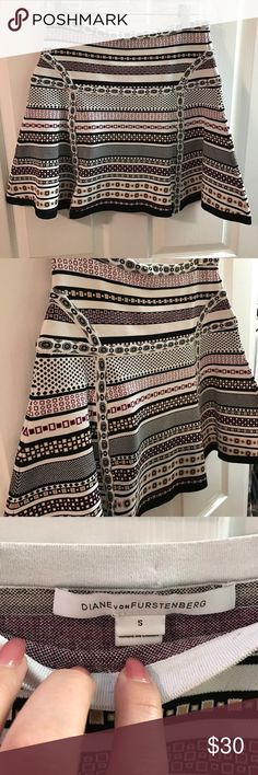 DVF SKIRT WORN ONCE! Stretchy mini flare skirt with beautiful design. Colors are black maroon and tan. Purchased at bloomies in 2015 Diane von Furstenberg Skirts Mini