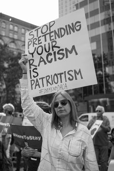 """Stop pretending your racism is patriotism #DefendDACA"" Donald Trump announced that he is repealing the program known as Deferred Action for Childhood Arrivals (DACA), which allows immigrants who entered the country as minors to receive a renewable two-year period of deferred action from deportation and eligibility for a work permit. Many undocumented minors will be at risk of being deported to a country they know nothing about. Photo credit: Cindy Trinh"