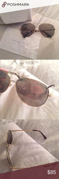 Michael Kors Kendall I Sunglasses Gold aviator Michael Kors Kendall I Sunglasses. No scratches, great condition. Reflective lens, you cannot see your eyes through them. Case and cloth included. Style code MK 5016. Price is firm. Michael Kors Accessories Sunglasses