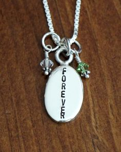 """Oval Hand Stamped Forever Personalized by Sterling silver necklace features one thick Oval Charm hand stamped with your choice of """"forever"""" and two Swarovski Crystal Dangles to represent your school or team colors. Charms hang on your choice of chain. (Sample is shown on a bead chain.)  Other options for charm:  Up to 7 letters vertically. Name Date High School  (LSH) College letters  (ex. asu, KU) kandsimpressions on Etsy"""