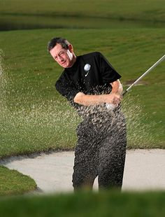 GET OUT OF A BUNKER EVERYTIME: Using your sand wedge, stand so the ball is even with your front instep, twist your feet in for stability, and focus on a spot about two inches behind the ball. Swing the club back about halfway then down and through that spot behind the ball. Keep turning your body so your chest faces the target at the finish