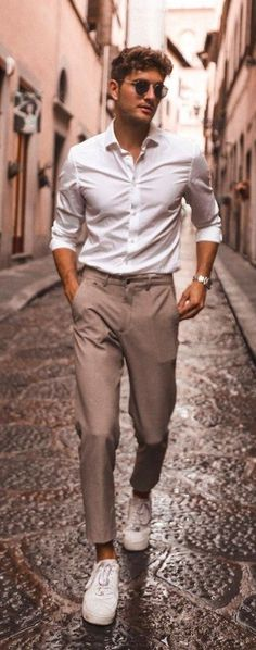 Classic White Shirt Khaki Pant Outfit with Sneakers Casual shirt trends are raging with so many new styles, shades and options.Here are the top 10 trends to look out for with styling options! Outfits Hipster, Stylish Mens Outfits, Mode Outfits, Vest Outfits, Swag Outfits, Most Stylish Men, Stylish Man, Stylish Clothes For Men, Men Hipster