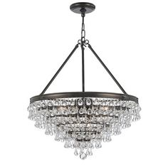 With an elegant antiqued-bronze finish and stunning rows of crystals placed in the shape of an inverted pyramid, this Outland chandelier shows your taste for elegance and refinement. Four lights brighten up any indoor space. Install this dramatic chandelier in your entryway to create a sophisticated look while giving your family sufficient light as they return from evening activities. Use it to update your formal dining room or living space, and incorporate the refined bronze finish and…