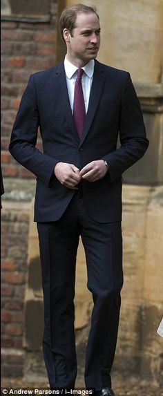 Back to school: Prince William walks around the grounds of St John's college as he starts at Cambridge University today