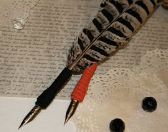 Orange-tip Pheasant quills with either orange or black suede ribbon and antqieu bronze pen nibs.