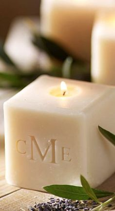 Monogrammed cube candles from Pottery Barn. Absolutely adore these.