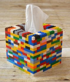 Share a bit of care with someone this cold and flu season with a fun gift pack and the instructions to make a DIY Tissue Box Cover from toy bricks.