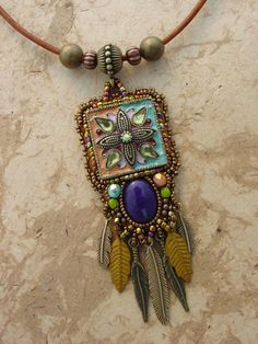 This is a very sweet one of a kind necklace. Using an old enamel piece of jewelry I found and transforming it into something new. A beautiful