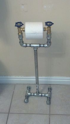 "1/2"" galvanized pipe with faucet valves to make a toilet paper dispenser holder. Fun and easy to make."