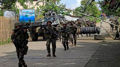 Philippine troops backed by attack helicopters battled dozens of Islamist militants holed up in a besieged southern city on Thursday.  The army sent about 100 soldiers, including U.S.-trained special forces, to retake buildings and streets in the mainly Muslim city of Marawi, rampaged earlier this week by militants of the Maute group, which has pledged allegiance to the self-styled Islamic State.