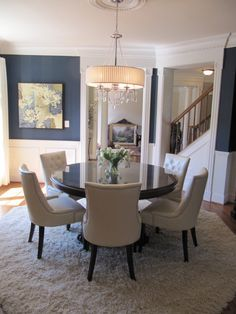 Navy, brown and off white contemporary dining room
