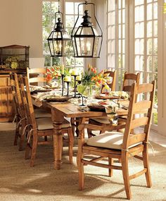 Simple Wooden Chairs And Rectangular Table With Flower Also Candles Centerpiece Plus Twin Rustic Lighting On Spring Dining Room