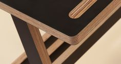The A Desk in Black, with pen tray detail.