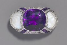 An amethyst, diamond and carved   moonstone set brooch by Koch, 1925