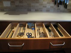 Fixed solid drawer dividers are a great way to keep your cooking utensils organized and you don't lose any valuable space as with plastic inserts.