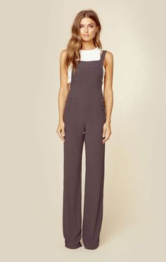 """Flynn Skye's Victoria Overall features adjustable shoulder straps, front and side pockets, and a relaxed easy fit. Pair over a bodysuit or vintage tee for a cool casual look.   Made in USADry Clean Only100% RayonFit Guide:Model is 5ft 7 inches; Bust: 32"""", Waist: 24"""", Hips: 34""""Model is wearing a size XSRelaxed FitShoes Featured Not Available For Purchase"""