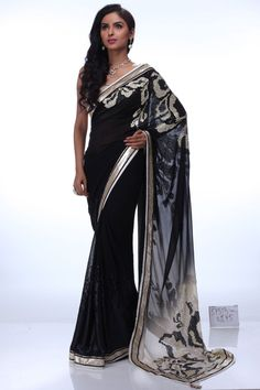 Set the temperature soaring with this scintillating saree. The silver color sequins work on the pallu and daman lends it a stunning look. The fine silver border enriches glamour, making it befitting for any evening do.Shop online at www.satyapaul.com and visit us at www.facebook.com/SatyaPaulIndia