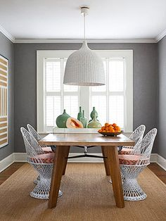 Gray walls with white trim and colorful accents