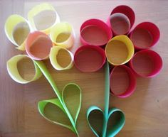 Paper Cylinder Flowers .  i think toilet rolls cut would be cute after the kids paint them of course.