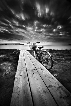 Bicycle, bike, 2 wheels, bridge, cloudy sky, shadow, Ocean view, beautiful, stunning, photograph, photo b/w.