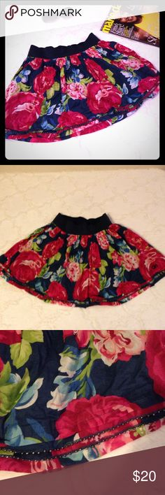 🛍 GILLY HICKS Floral Print Skirt Red rose watercolor floral print skirt with navy elastic waist. Beaded hem. Lined.  ▪REASONABLE OFFERS WELCOMED or BUNDLE FOR 15% OFF!▪️ Gilly Hicks Skirts