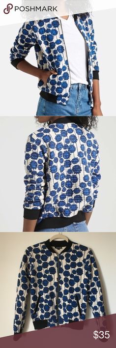 Topshop Floral Bomber Jacket Super cute bomber jacket in an eye-catching floral print. Crafted in soft, comfy cotton. Bought off Posh, but also just bought 3 other bomber jackets... oops. In fantastic condition! Topshop Jackets & Coats