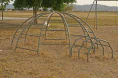 old school monkey bars... broke my arm on one of these babies. Here is a good idea, lets send 200 kids outside to play on death traps. How many times did you get knocked off and knock the wind out of yourself! Oh to be 6 years old again!