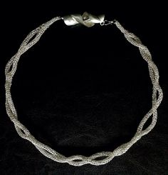Twisting Silver, knitted argentium silver cord, foldformed argentium silver clasp, Sharon Stafford Metals, 2016