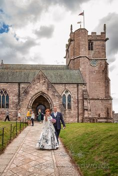 Bride and groom walk hand in hand from Corfe Castle ancient stone church wedding venue in Dorset. Photograph by one thousand words wedding photographers Church Wedding Ceremony, Wedding Venues, Corfe Castle, One Thousand, Photographers, Groom, Bride, Stone, Travel