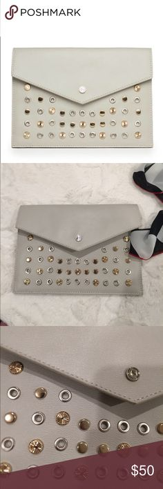Danielle Nicole Clutch Brand new studded clutch. Dimension 10x7x1 ivory color Danielle Nicole Bags Clutches & Wristlets