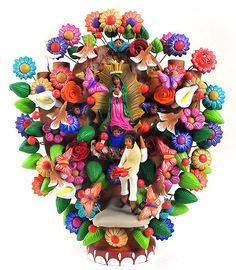 Mexican tree of life is the name given to a hand coiled pottery sculpture depicting the biblical tree of life; traditionally the tree sculpture would include Adam and Eve with the tempting Serpent but the themes have evolved and today is common to find trees about various subjects such as Day of the Dead and Folk Art.