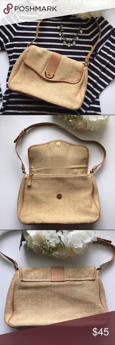 Etienne Aigner // Woven Canvas Shoulder Bag - tan This lovely bag is in excellent, unused condition from Etienne Aigner. Features a woven canvas material on the outside with leather bottom and piping. There are two big pockets inside with zippers. There's also a smaller wallet sized zippered pocket. Two open pockets to hold a phone or tissues. Great quality bag in great shape. Etienne Aigner Bags Shoulder Bags