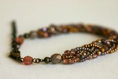 Five Strand Czech Bead and Seed Bead Braided Bracelet. ¥2,300, via Etsy.
