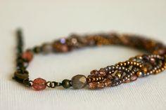 Five Strand Czech Bead and Seed Bead Braided Bracelet. ¥2,300, via Etsy.