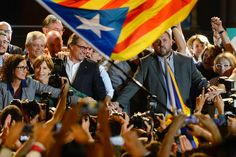 President of Catalonia Artur Mas (C) and President of Catalonia 'Esquerra Republicana de Catalunya' party (ERC) Oriol Junqueras (R) celebrate as the Catalanist coalition 'Junts Pel Si' (Together for the Yes) reportedly look close to winning the regional elections held in Catalonia on September 27, 2015 in Barcelona.