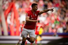 Robert Lewandowski of Muenchen celebrates after scoring his team's first goal during the Bundesliga match between FC Bayern Muenchen and Hannover 96...