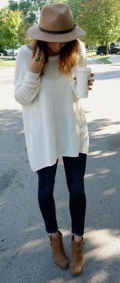 Women's fashion trends 2017! Transition from Summer to Fall to Spring with great items like these. Long cream cashmere sweater, jeggings and booties.