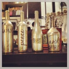 Faux mercury glass on wine bottles with vinyl letters, I did this myself- actually COMPLETED a project inspired by Pinterest!! Krylon looking glass spray paint, vinegar to distress, sealed with clear gloss acrylic.
