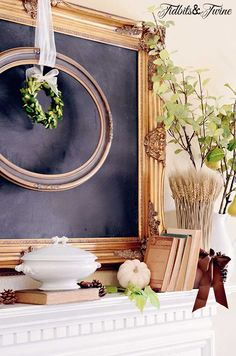TIDBITS-&-TWINE-Fall-Mantel-Books-Pumpkins-and-Pears.  Love the framed Chalkboard, empty round frame and wreath in center of it all.  DG