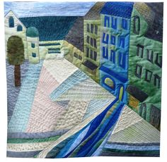 Quilt by Susanne Blum, Germany. This quilt shows the shop at Sebastiansplatz in Munich, with a blue path leading towards it.  Posted by Quilt Art News.