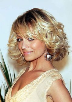 Then a short, curly bob. | The Hair Evolution Of Nicole Richie