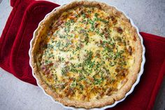 Quiche Lorraine Recipe Breakfast and Brunch with pie dough, bacon, milk, heavy cream, eggs, salt, black pepper, ground nutmeg, grated Gruyère cheese, chives
