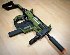 Nerf Stryfe Kriss Vector Black/Military by JLCustomsCreations Sci Fi Weapons, Concept Weapons, Weapons Guns, Airsoft Guns, Guns And Ammo, Kriss Vector, Vector 45, Modified Nerf Guns, Cool Nerf Guns