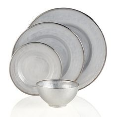 Perfectly polished Paramount Dinnerware sets an elegant holiday table. Set of 4, $51.80 - $79.80