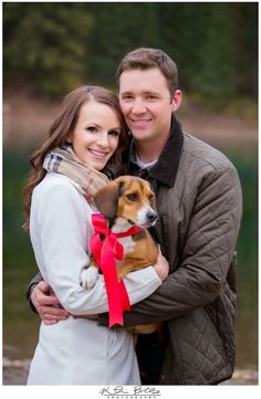 Couple with their dog photography ideas! Love the bow on the dog.