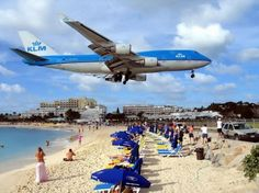 Maho Beach, St. Maarten. I'm heading to St. Maarten this December, I think I'll have to pay this beach a visit.