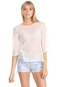 The Sugarlips Plenty Cute Top is a gorgeous 3/4 sleeve boat neck zig zag print knit top. Pair it with a colored cut off short to complete the look. #MyLuluCloset #Sugarlips #Storenvy #Sales #Tops