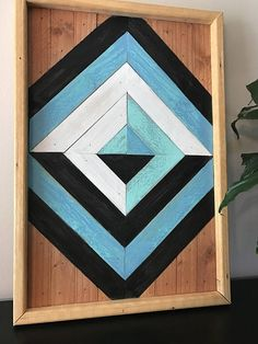 Handmade Geometric Wood Art. Each piece is stained, cut, and arranged to create an eye-catching pattern to enhance any space. Perfect for a housewarming, anniversary, Christmas, wedding, or birthday gift! • Piece measures approximately 13 x 19 inches. • Hanging hardware included, so