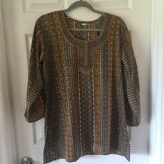 Indian Silk Tunic Gold Gorgeous detail in this silk tunic from India. Great for summer. Long sleeved. Three different styles available, see other listings. All in excellent, like new condition. Tops Tunics